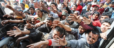 migrants-1550x660.jpg